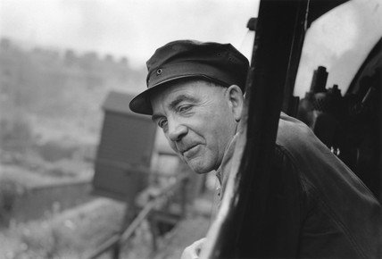 Driver Bill Hoole leans from the cab of his A4 clas locomotive, c 1950s.