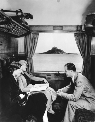 Pasengers in a GWR carriage going past St Michael's Mount, 1936.