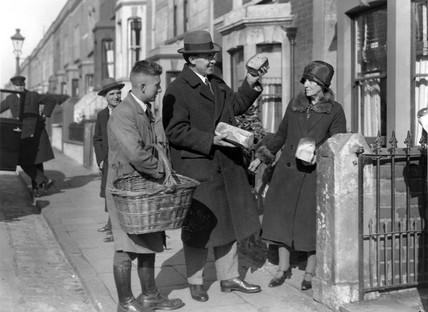 Sir Stafford Cripps canvasing a baker, Bristol, 24 October 1931.