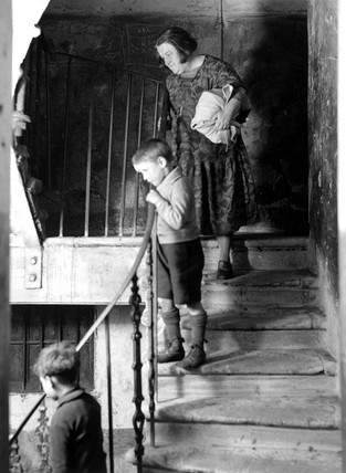 A family on the stairway of their tenement