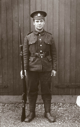 Soldier in uniform posing with his rifle, 1914-1918.