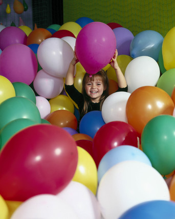 Girl with balloons during  'Energy Balloons' event, September 2000.