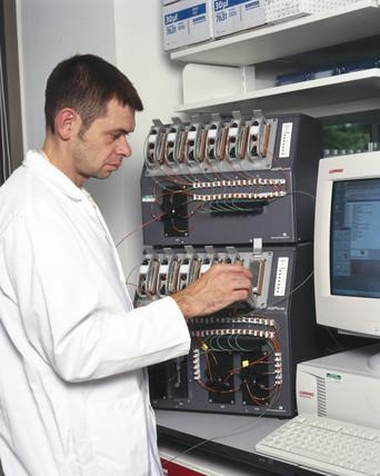 A scientist loading DNA samples.