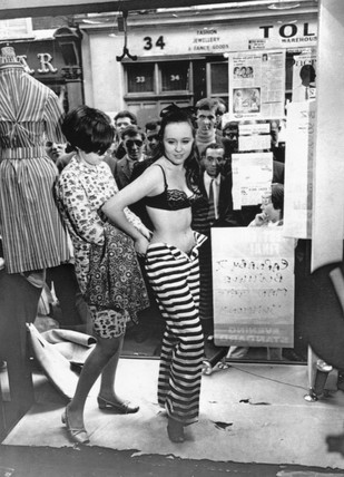Dresing a model in the window of a boutique, 13 May 1966.