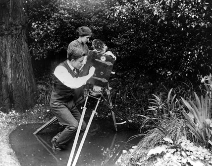 F Percy Smith, English filmmaking pioneer, filming in a pond, c 1910.