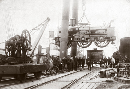 Loading a steam locomotive onto a ship, Newhaven, East Susex, late 1800s.