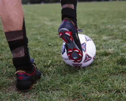 A football boot about to strike a ball, October 2000.