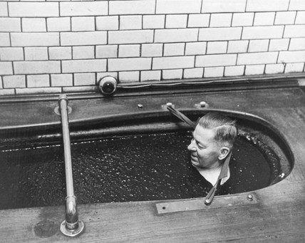 Man relaxing in a peat bath, 15th December 1960.
