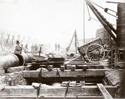 Laying timber on the Metropolitan District Railway, London, c 1868.