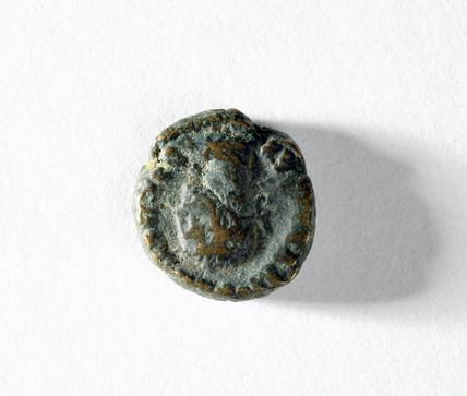 Small bras coin believed to depict Alexander the Great, 330 BC.