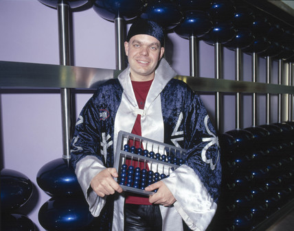 'Wizard' with giant abacus, Science Museum, London, June 2001.