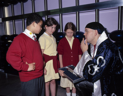 Children learning how an abacus works, Science Museum, London, 2001.
