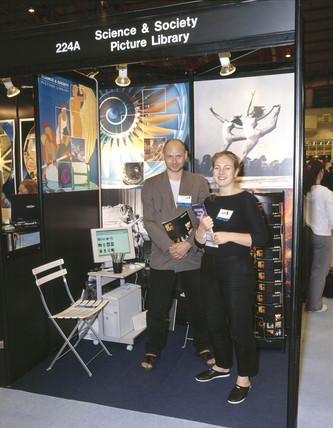 Picture library staff at a trade fair in London, 2001.