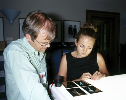 Picture researcher and curator viewing transparencies, sPL, July 2001.