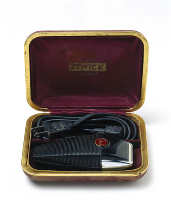 Schick electric razor in case, c 1934.