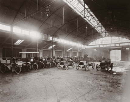 Motor cars parked inside Lillie Hall, Fulham, London, 1902.
