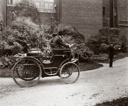 C S Rolls and pasenger in Rolls' first car, 1896.