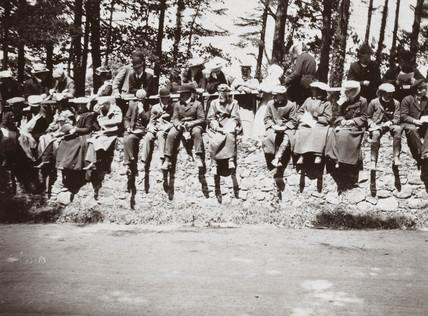 Spectators sitting on a wall at Castlewellan Hill Climb, Ireland, 1903.