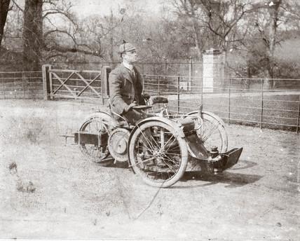 C S Rolls on a 4 hp Bollee Tri-Car, c 1898.