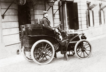 C S Rolls at the wheel of his 8 hp Panhard, 1898.