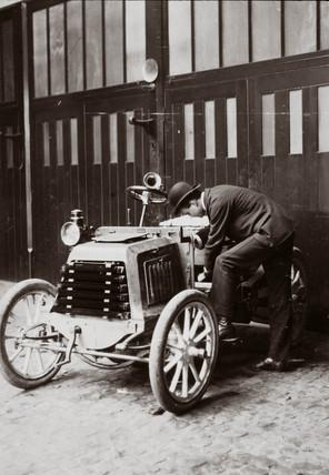 C S Rolls inspecting a motor car, c 1900.