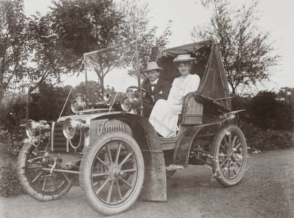 C S Rolls with a female companion sitting in his 15 hp Panhard, 1903.