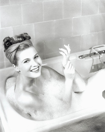 Young woman taking a bath, 1960-1965.