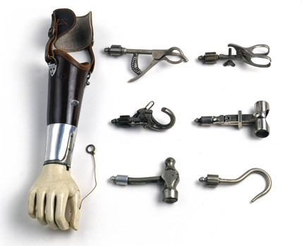 Artificial arm with attachments, c 1921-1930.