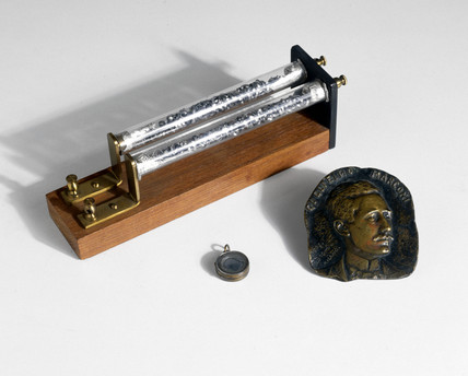Coherer, 1894, bas-relief of Guglielmo Marconi, 1903, and locket, c 1916.