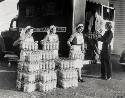 Red Cros Nurses loading dehydrated blood into a van, 20 November 1942.