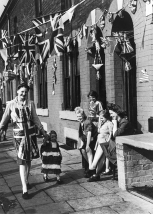 Woman and child dresed in Union Jacks, VE Day, Manchester, 8 May 1945.