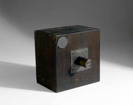 Camera with lens and metal focusing cover, c 1840.