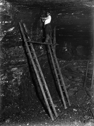 Cutting the top layers of the famous ten yard seam, Staffordshire, c 1890s.