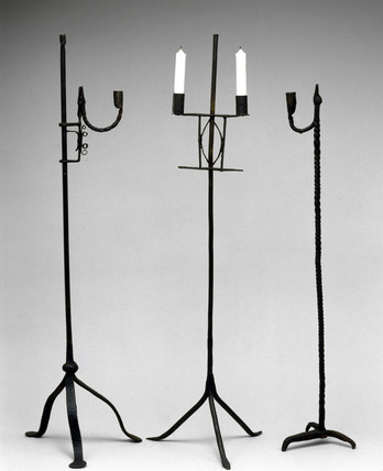 Three floor-standing candlesticks, c 18th century.