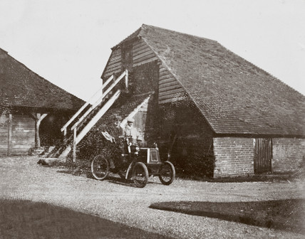 C S Rolls' 6 hp Renault motor car parked outside a farm building, c 1902.