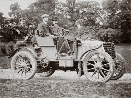 C S Rolls behind the wheel of his 24 hp Panhard with two pasengers, 1902.