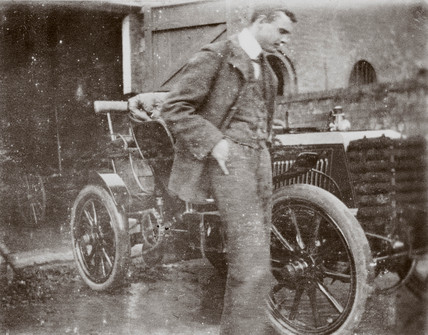 C S Rolls standing beside his 24 hp Panhard, 1902.