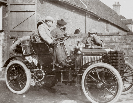 C S Rolls behind the wheel of his 24 hp Panhard, with a pasenger, 1902.