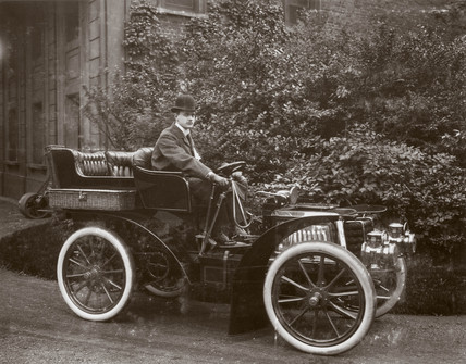 C S Rolls behind the wheel of his 24 hp Panhard motor car, 1902.
