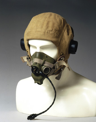 Flying helmet with oxygen mask and headphones, c WWII.