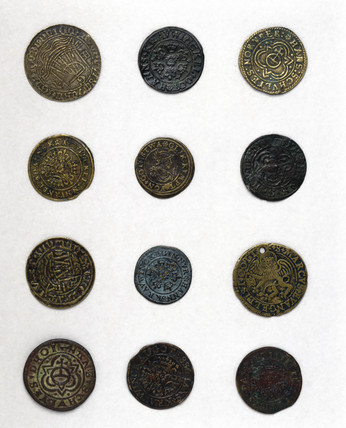 Twelve German jetons, 16th century.