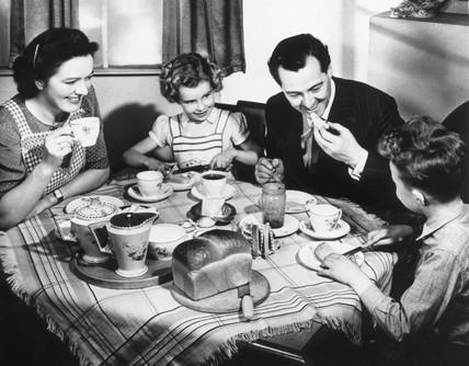 A family taking tea, 1940s.