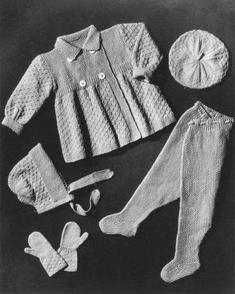 A selection of knitwear for a small child,