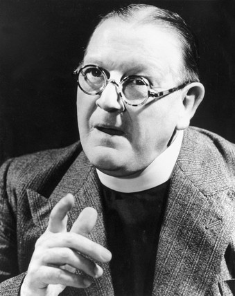 Bespectacled clergyman giving a sermon, 194