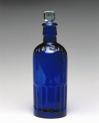 Blue glas reagent bottle with 'POISON' embosed on the neck, 1930.