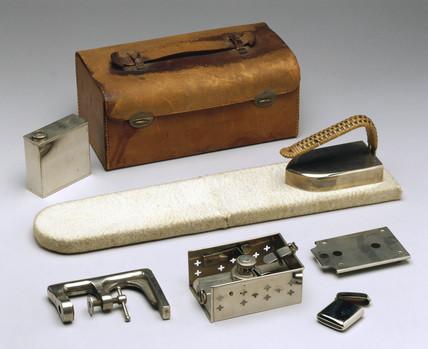Travelling spirit iron set, with folding ironing board, 1890.