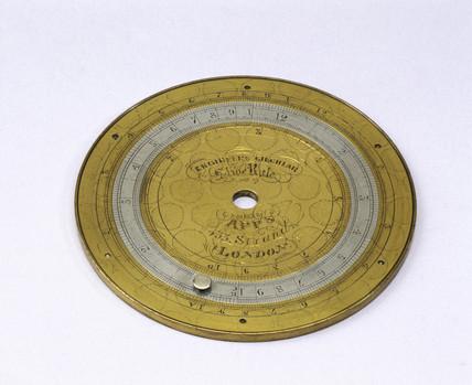 Circular slide rule, c 1870.