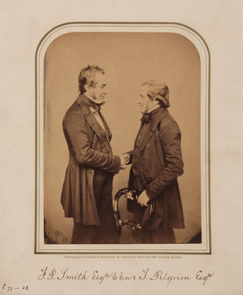 Pettit Smith, marine engineer, shaking hands with Thomas Pilgrim, 1854-1859.