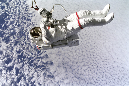 Mark Lee tetherles and free testing a SAFER system during EVA, 1994.
