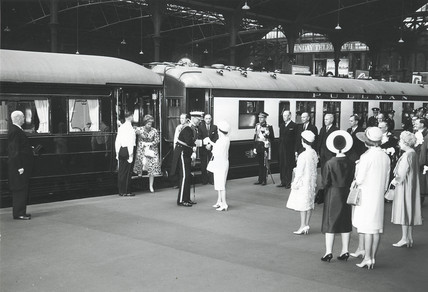 The Queen shaking hands with a naval officer in front of Royal Train, c 1960.